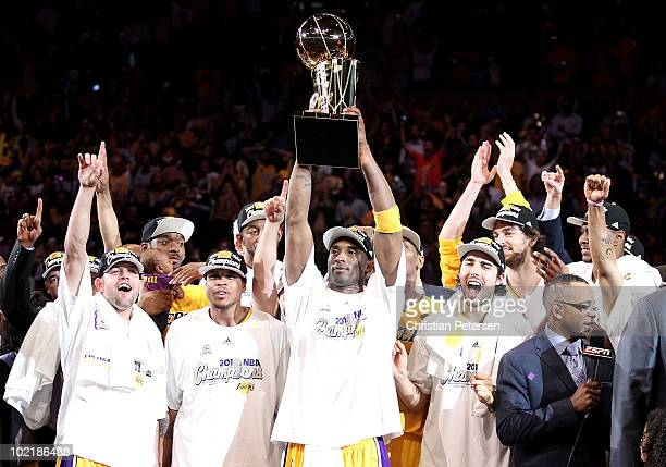 Kobe Bryant of the Los Angeles Lakers holds up the Larry O'Brien trophy after the Lakers defeated the Boston Celtics in Game Seven of the 2010 NBA...