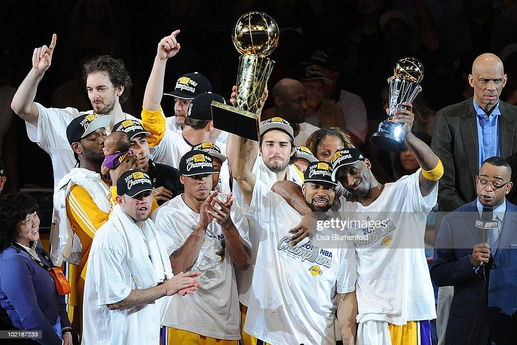 Kobe Bryant #24 of the Los Angeles Lakers holds up the Larry O'Brien trophy after the Lakers defeated the Boston Celtics 83-79 in Game Seven of the 2010 NBA Finals at Staples Center on June 17, 2010 in Los Angeles, California.