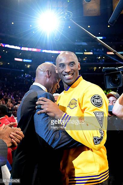 Kobe Bryant of the Los Angeles Lakers hugs head coach Byron Scott before taking on the Utah Jazz in Bryant's final NBA game at Staples Center on...