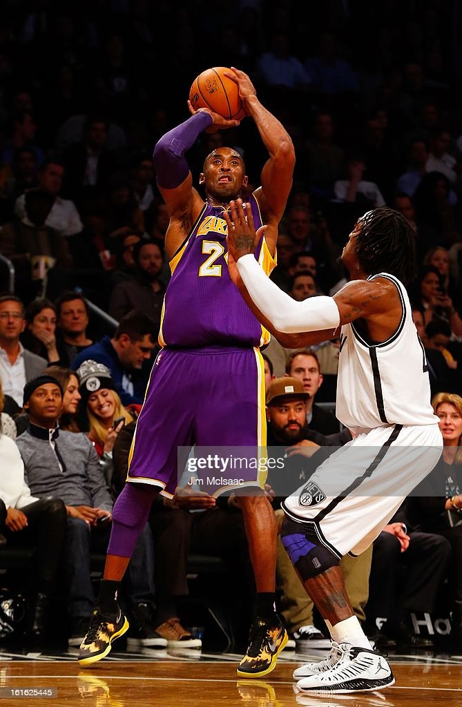 Kobe Bryant #24 of the Los Angeles Lakers in action against Gerald Wallace #45 of the Brooklyn Nets at Barclays Center on February 5, 2013 in the Brooklyn borough of New York City.The Lakers defeated the Nets 92-83.