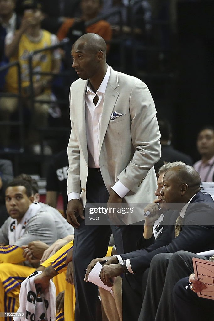 <a gi-track='captionPersonalityLinkClicked' href=/galleries/search?phrase=Kobe+Bryant&family=editorial&specificpeople=201466 ng-click='$event.stopPropagation()'>Kobe Bryant</a> #24 of the Los Angeles Lakers in action against the Golden State Warriors during the 2013 Global Games at the Mercedes-Benz Arena on October 18, 2013 in Shanghai, China.