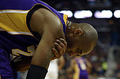 Kobe Bryant of the Los Angeles Lakers injures his right shoulder during a game against the New Orleans Pelicans at the Smoothie King Center on...
