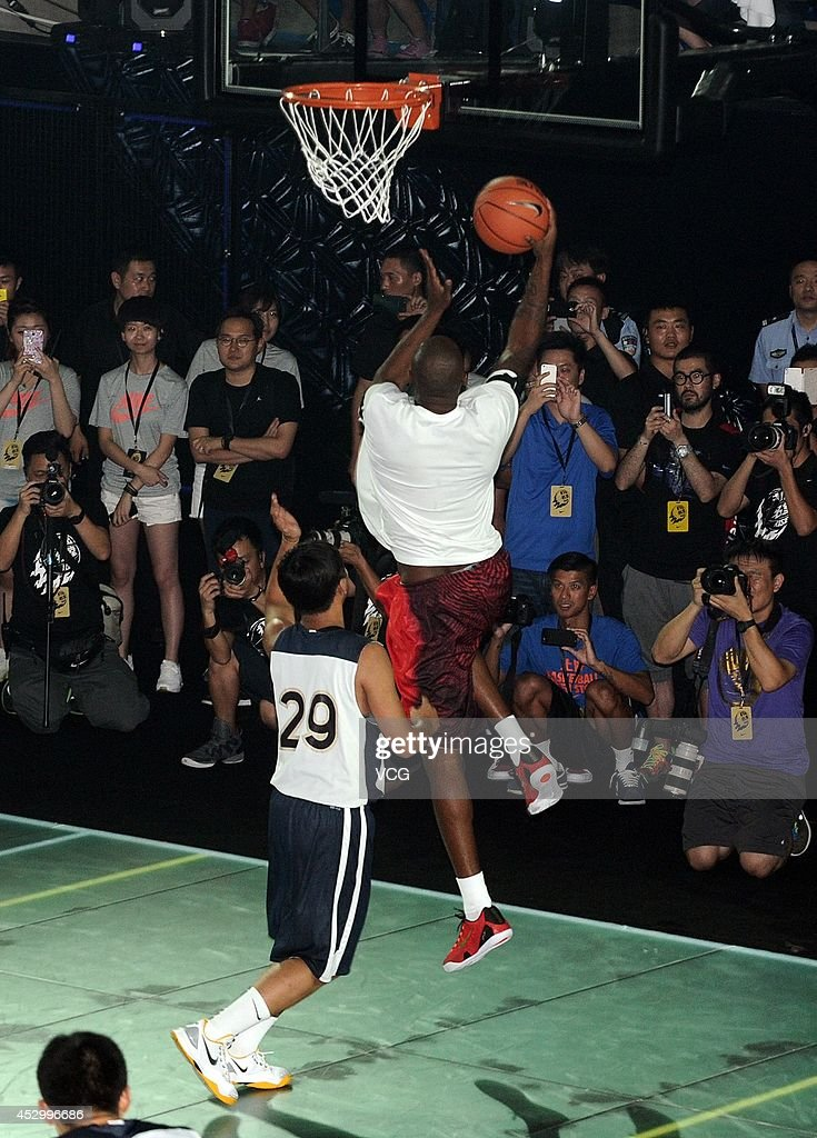 Kobe Bryant of the Los Angeles Lakers interacts with a fan during a promotional event at Jiangwan Stadium on July 31, 2014 in Shanghai, China.