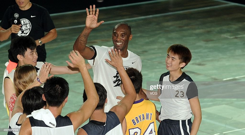 <a gi-track='captionPersonalityLinkClicked' href=/galleries/search?phrase=Kobe+Bryant&family=editorial&specificpeople=201466 ng-click='$event.stopPropagation()'>Kobe Bryant</a> of the Los Angeles Lakers interacts with fans during a promotional event at Jiangwan Stadium on July 31, 2014 in Shanghai, China.
