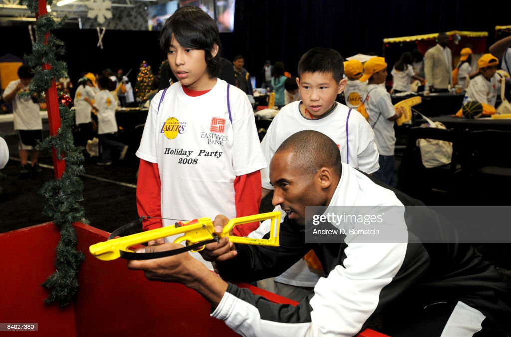 <a gi-track='captionPersonalityLinkClicked' href=/galleries/search?phrase=Kobe+Bryant&family=editorial&specificpeople=201466 ng-click='$event.stopPropagation()'>Kobe Bryant</a> #24 of the Los Angeles Lakers interacts with participants at the 2008 Los Angeles Lakers holiday party at Toyota Sports Center on December 13, 2008 in El Segundo, California.