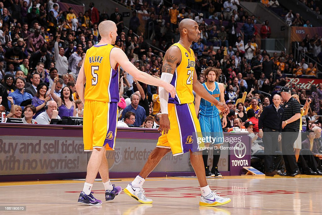 Kobe Bryant #24 of the Los Angeles Lakers is congratulated by teammate Steve Blake #5 after making a shot against the New Orleans Hornets at Staples Center on April 9, 2013 in Los Angeles, California.