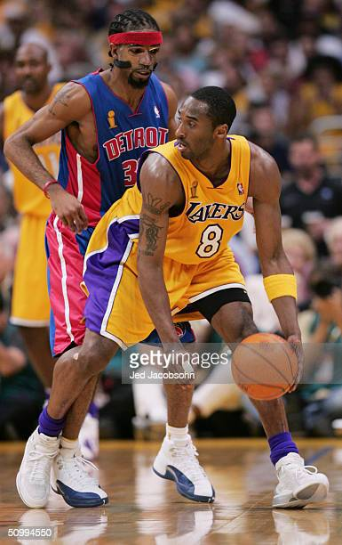 Kobe Bryant of the Los Angeles Lakers is defended by Richard Hamilton of the Detroit Pistons in Game two of the 2004 NBA Finals at Staples Center on...