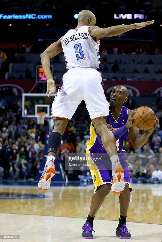 Kobe Bryant #24 of the Los Angeles Lakers is fouled by Gerald Henderson #9 of the Charlotte Bobcats late in the fourth quarter during their game at Time Warner Cable Arena on December 14, 2013 in Charlotte, North Carolina.