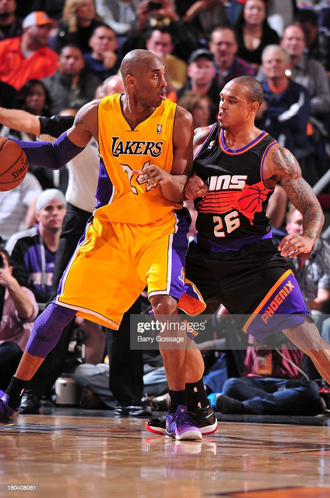 Kobe Bryant #24 of the Los Angeles Lakers is guarded by Shannon Brown #26 of the Phoenix Suns on January 30, 2013 at U.S. Airways Center in Phoenix, Arizona.