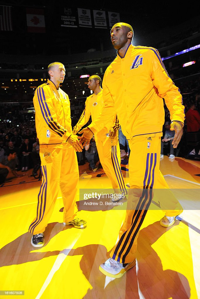 Kobe Bryant #24 of the Los Angeles Lakers is introduced in the starting lineup before facing the Phoenix Suns at Staples Center on February 12, 2013 in Los Angeles, California.