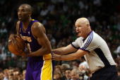 Kobe Bryant of the Los Angeles Lakers is pushed in the back by referee Joe Crawford while taking on the Boston Celtics in Game Six of the 2008 NBA...