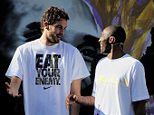 Kobe Bryant of the Los Angeles Lakers jokes with his teammate Pau Gasol during the 'House of Hoops' contest by Foot Locker on October 6 2010 in...