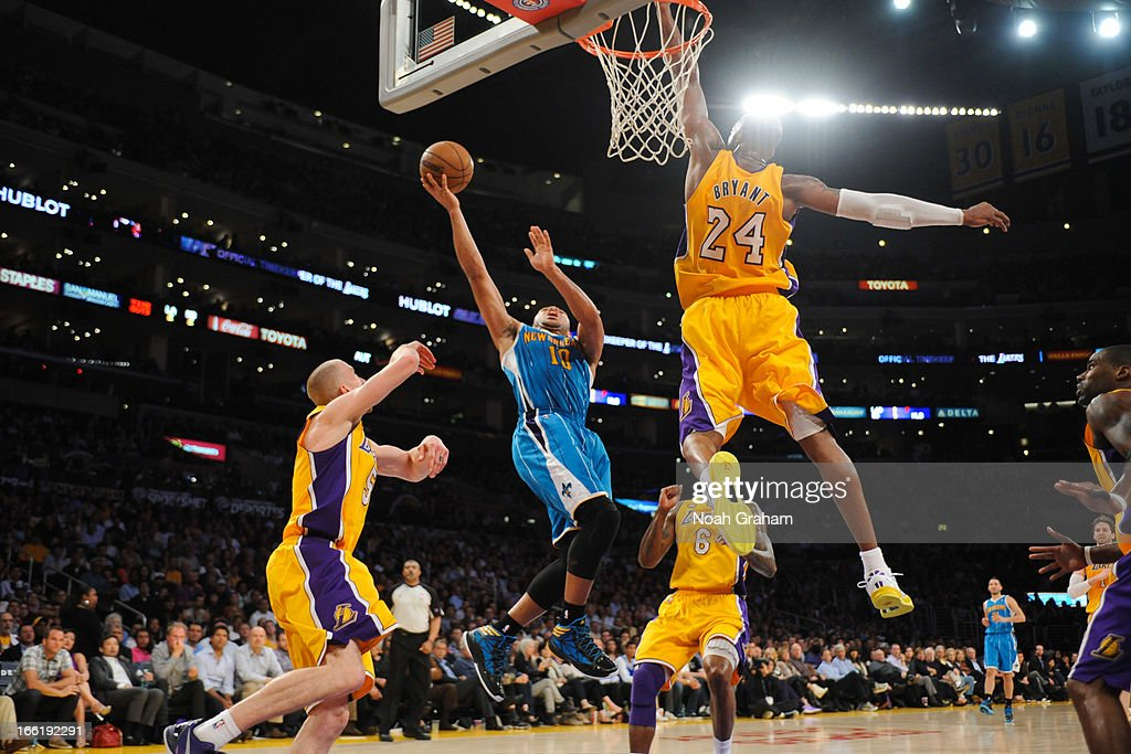 Kobe Bryant #24 of the Los Angeles Lakers jumps to contest a shot attempt by Eric Gordon #10 of the New Orleans Hornets at Staples Center on April 9, 2013 in Los Angeles, California.