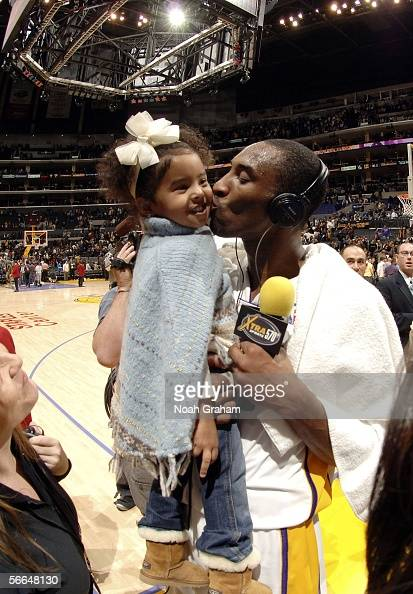Kobe Bryant of the Los Angeles Lakers kisses his daughter Natalia after he scored 81 points against the Toronto Raptors on January 22 2006 at Staples...
