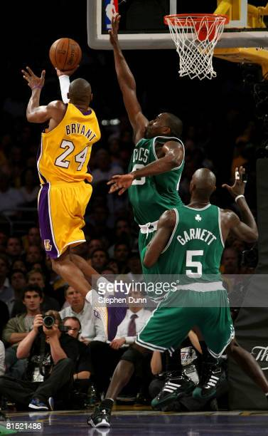 Kobe Bryant of the Los Angeles Lakers lays the ball up over Kendrick Perkins and Kevin Garnett of the Boston Celtics in Game Three of the 2008 NBA...