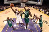 Kobe Bryant of the Los Angeles Lakers lays the ball up over Ray Allen and Kedrick Perkins of the Boston Celtics in Game Two of the 2010 NBA Finals at...