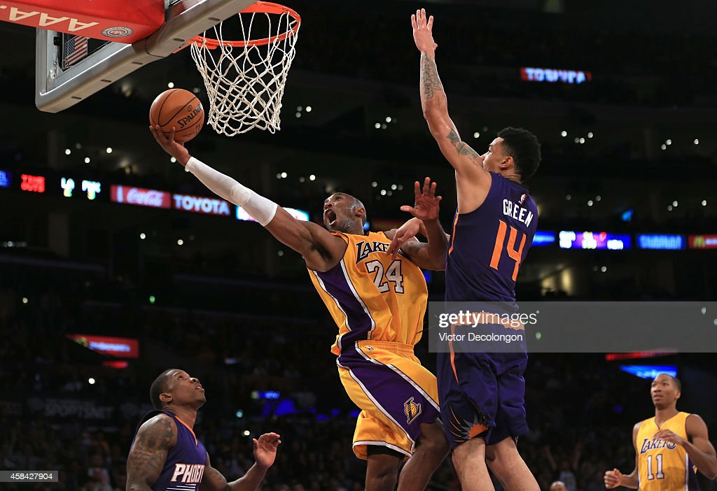 <a gi-track='captionPersonalityLinkClicked' href=/galleries/search?phrase=Kobe+Bryant&family=editorial&specificpeople=201466 ng-click='$event.stopPropagation()'>Kobe Bryant</a> #24 of the Los Angeles Lakers lays up a shot against <a gi-track='captionPersonalityLinkClicked' href=/galleries/search?phrase=Gerald+Green&family=editorial&specificpeople=644655 ng-click='$event.stopPropagation()'>Gerald Green</a> #14 of the Phoenix Suns in the second half during the NBA game at Staples Center on November 4, 2014 in Los Angeles, California. The Suns defeated the Lakers 112-106.