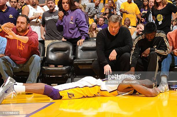 Kobe Bryant of the Los Angeles Lakers lies on the floor after falling into a row of courtside seats against the New Orleans Hornets in Game One of...