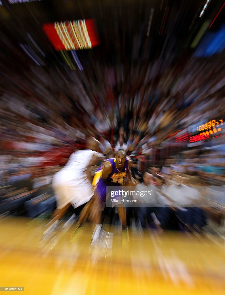 Kobe Bryant #24 of the Los Angeles Lakers looks down Ray Allen #34 of the Miami Heat during a game at American Airlines Arena on February 10, 2013 in Miami, Florida.