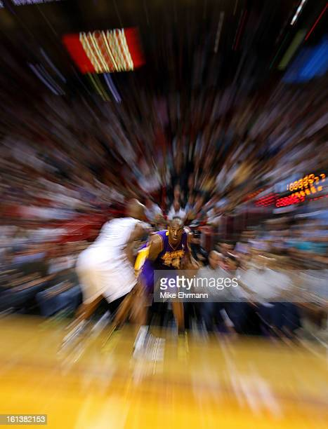 Kobe Bryant of the Los Angeles Lakers looks down Ray Allen of the Miami Heat during a game at American Airlines Arena on February 10 2013 in Miami...