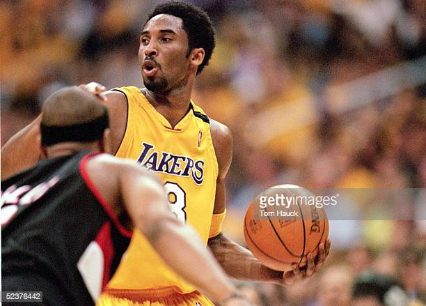 Kobe Bryant of the Los Angeles Lakers looks for an open man during Game 7 of the Western Conference Finals against the Portland Trail Blazers at...
