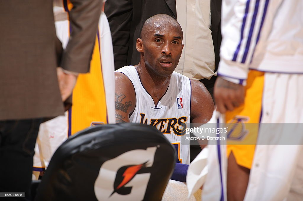 Kobe Bryant #24 of the Los Angeles Lakers looks on from the bench against the Utah Jazz at Staples Center on December 9, 2012 in Los Angeles, California.