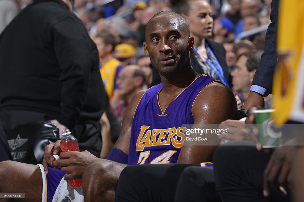 Kobe Bryant #24 of the Los Angeles Lakers looks on from the bench during the game against the Philadelphia 76ers at the Wells Fargo Center on December 1, 2015 in Philadelphia, Pennsylvania.