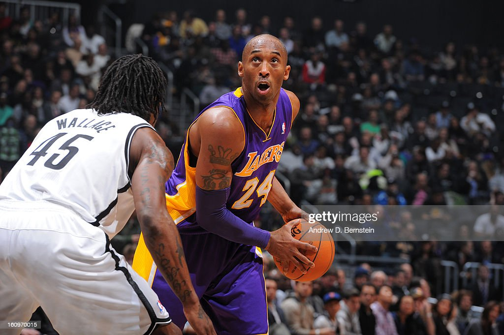 Kobe Bryant #24 of the Los Angeles Lakers looks to make a move against Gerald Wallace #45 of the Brooklyn Nets on February 5, 2013 at the Barclays Center in the Brooklyn borough of New York City.
