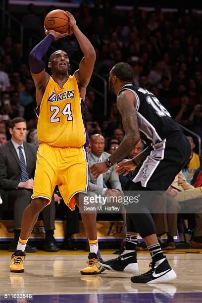 Kobe Bryant of the Los Angeles Lakers looks to pass past Rasual Butler of the San Antonio Spurs during the second half of a game at Staples Center on...