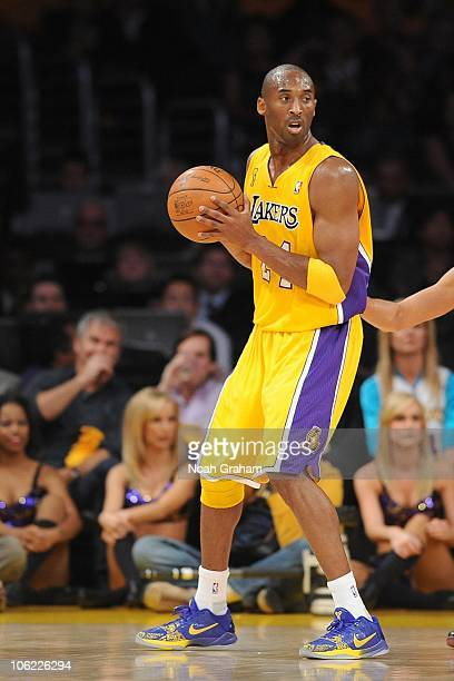 Kobe Bryant of the Los Angeles Lakers looks to pass the ball against the Houston Rockets during their opening night game at Staples Center on October...