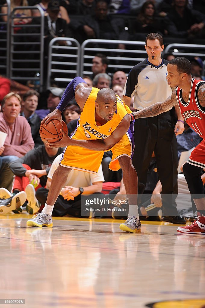 <a gi-track='captionPersonalityLinkClicked' href=/galleries/search?phrase=Kobe+Bryant&family=editorial&specificpeople=201466 ng-click='$event.stopPropagation()'>Kobe Bryant</a> #24 of the Los Angeles Lakers looks to pass the ball against the Milwaukee Bucks at Staples Center on January 15, 2013 in Los Angeles, California.