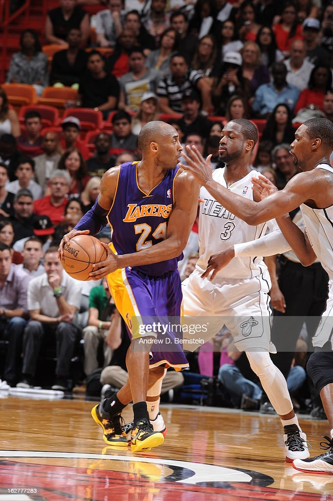 <a gi-track='captionPersonalityLinkClicked' href=/galleries/search?phrase=Kobe+Bryant&family=editorial&specificpeople=201466 ng-click='$event.stopPropagation()'>Kobe Bryant</a> #24 of the Los Angeles Lakers looks to pass the ball against <a gi-track='captionPersonalityLinkClicked' href=/galleries/search?phrase=Dwyane+Wade&family=editorial&specificpeople=201481 ng-click='$event.stopPropagation()'>Dwyane Wade</a> #3 and <a gi-track='captionPersonalityLinkClicked' href=/galleries/search?phrase=Chris+Bosh&family=editorial&specificpeople=201574 ng-click='$event.stopPropagation()'>Chris Bosh</a> #1 of the Miami Heat on February 10, 2013 at American Airlines Arena in Miami, Florida.