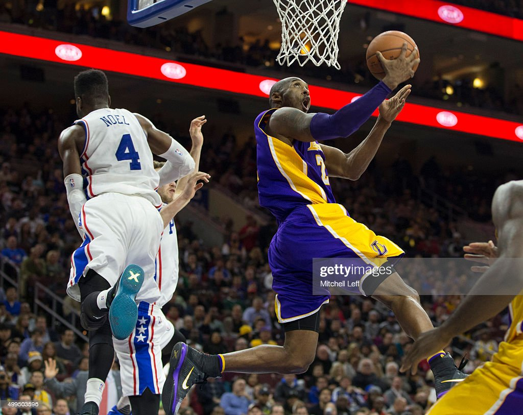 Kobe Bryant #24 of the Los Angeles Lakers makes a layup over Nerlens Noel #4 of the Philadelphia 76ers on December 1, 2015 at the Wells Fargo Center in Philadelphia, Pennsylvania.