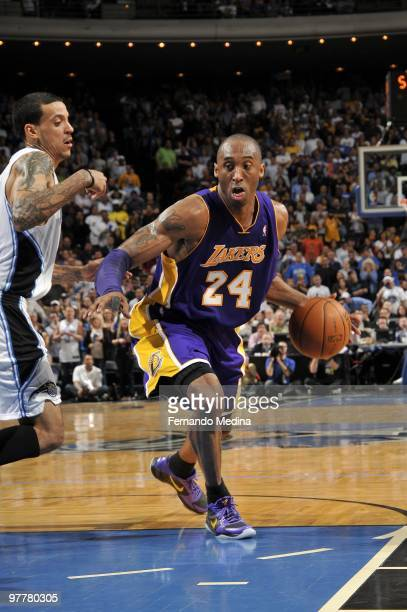 Kobe Bryant of the Los Angeles Lakers makes a move to the basket against Matt Barnes of the Orlando Magic during the game at Amway Arena on March 7...