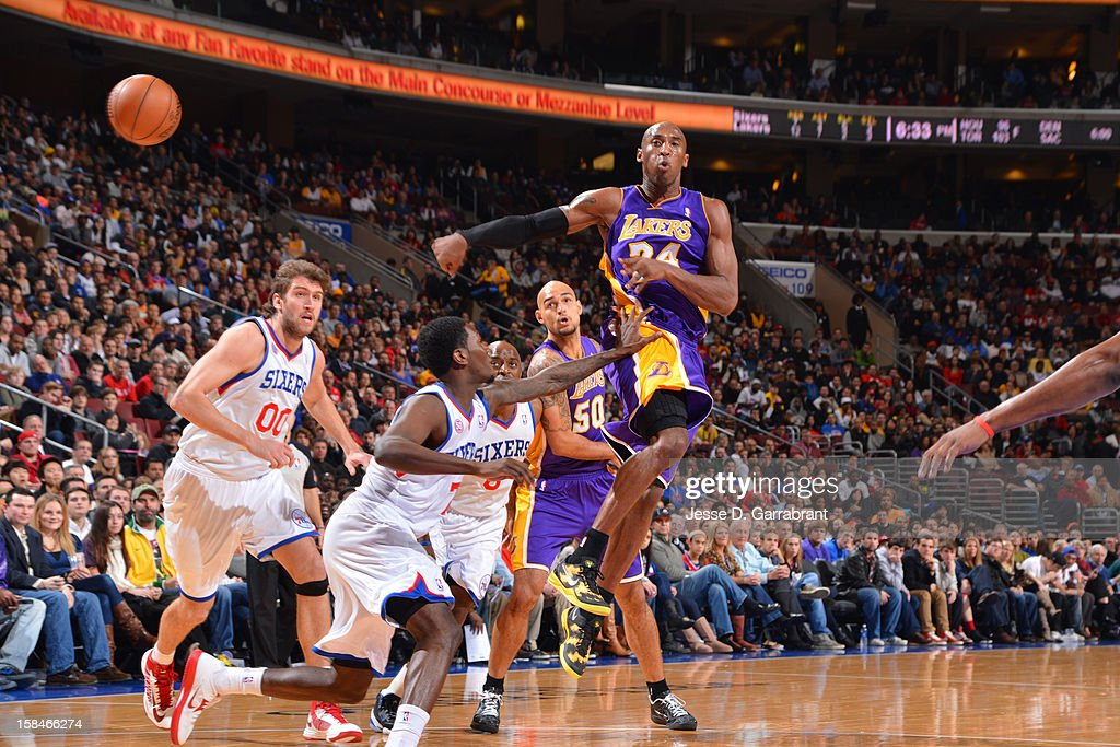Kobe Bryant #24 of the Los Angeles Lakers makes a pass against the Philadelphia 76ers on December 16, 2012 at the Wells Fargo Center in Philadelphia, Pennsylvania.
