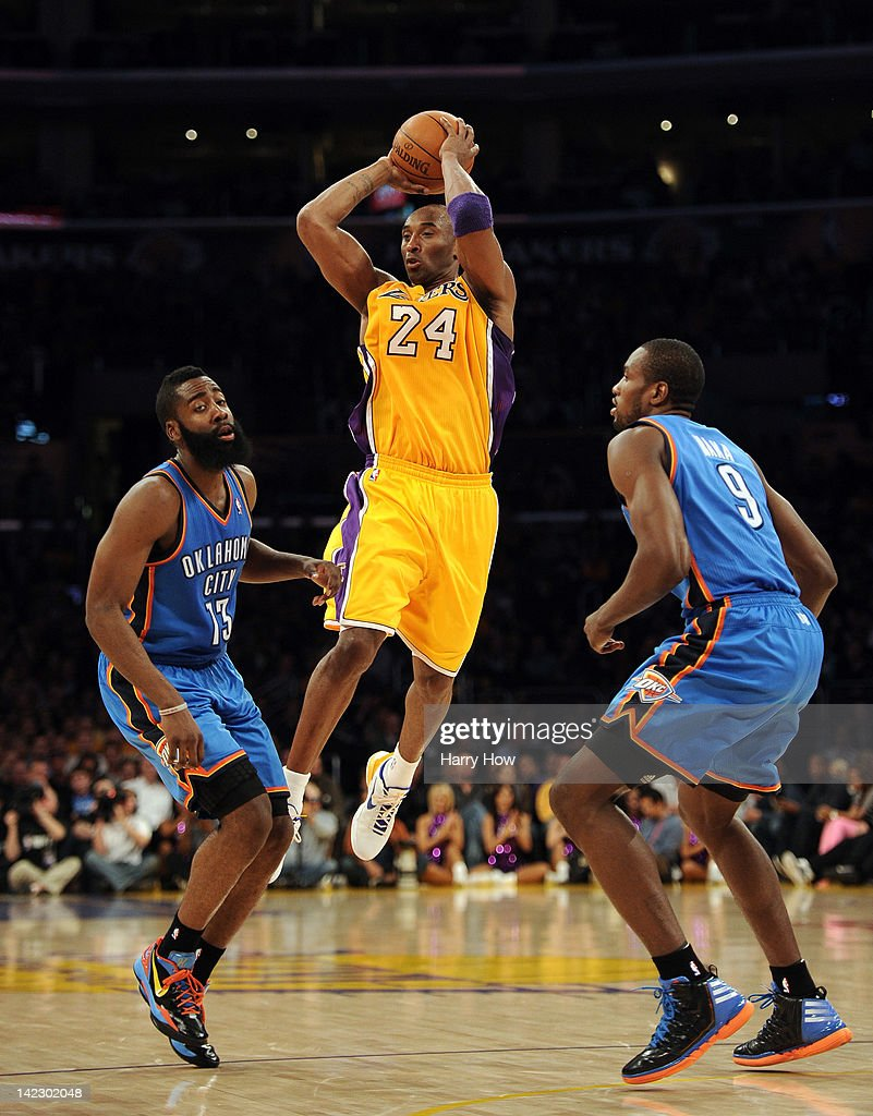 <a gi-track='captionPersonalityLinkClicked' href=/galleries/search?phrase=Kobe+Bryant&family=editorial&specificpeople=201466 ng-click='$event.stopPropagation()'>Kobe Bryant</a> #24 of the Los Angeles Lakers makes a pass in front of <a gi-track='captionPersonalityLinkClicked' href=/galleries/search?phrase=James+Harden&family=editorial&specificpeople=4215938 ng-click='$event.stopPropagation()'>James Harden</a> #13 and <a gi-track='captionPersonalityLinkClicked' href=/galleries/search?phrase=Serge+Ibaka&family=editorial&specificpeople=5133378 ng-click='$event.stopPropagation()'>Serge Ibaka</a> #9 of the Oklahoma City Thunder at Staples Center on March 29, 2012 in Los Angeles, California.