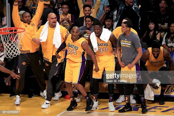 Kobe Bryant of the Los Angeles Lakers makes a shot and celebrates with teammates in the first half against the Utah Jazz at Staples Center on April...
