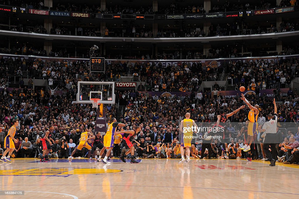 <a gi-track='captionPersonalityLinkClicked' href=/galleries/search?phrase=Kobe+Bryant&family=editorial&specificpeople=201466 ng-click='$event.stopPropagation()'>Kobe Bryant</a> #24 of the Los Angeles Lakers makes a three-pointer to tie the game and force overtime against the Toronto Raptors at Staples Center on March 8, 2013 in Los Angeles, California.