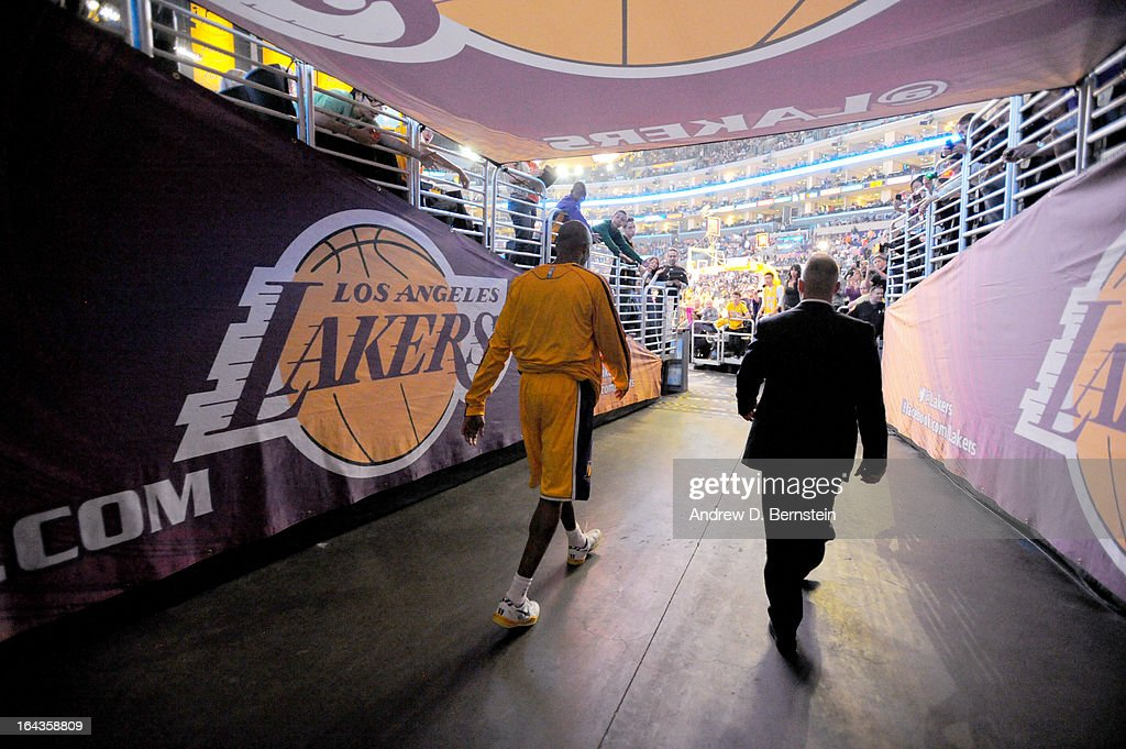 Kobe Bryant #24 of the Los Angeles Lakers makes his way back to the court after halftime of a game against the Washington Wizards at Staples Center on March 22, 2013 in Los Angeles, California.