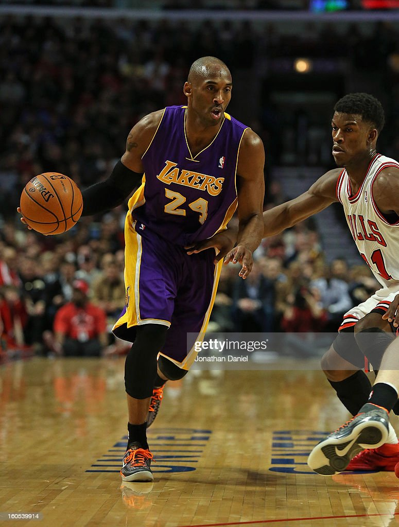 Kobe Bryant #24 of the Los Angeles Lakers moves against Jimmy Butler #21 of the Chicago Bulls at the United Center on January 21, 2013 in Chicago, Illinois. The Bulls defeated the Lakers 95-83.