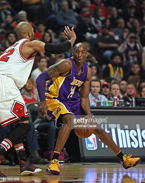 Kobe Bryant of the Los Angeles Lakers moves against Taj Gibson of the Chicago Bulls at the United Center on February 21 2016 in Chicago Illinois NOTE...