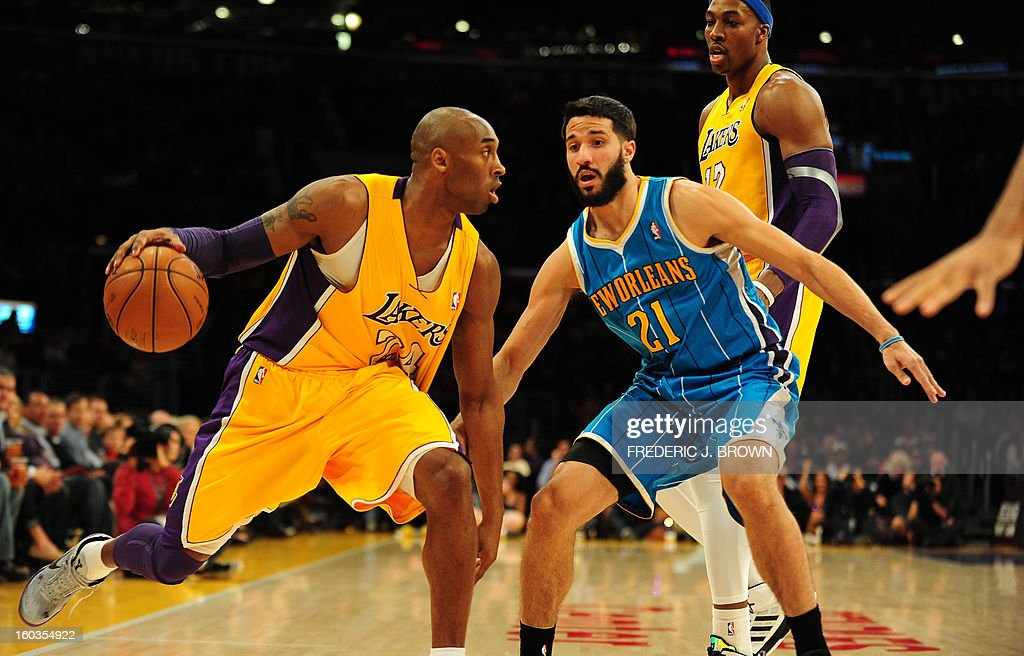 Kobe Bryant (L) of the Los Angeles Lakers moves the ball against Greivis Vasquez (R) of the New Orleans Hornets during their NBA game on January 29, 2013 at Staples Center in Los Angeles, California. AFP PHOTO / Frederic J. BROWN
