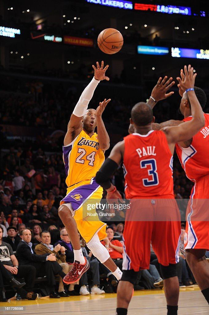Kobe Bryant #24 of the Los Angeles Lakers passes against Chris Paul #3 of the Los Angeles Clippers at Staples Center on February 14, 2013 in Los Angeles, California.