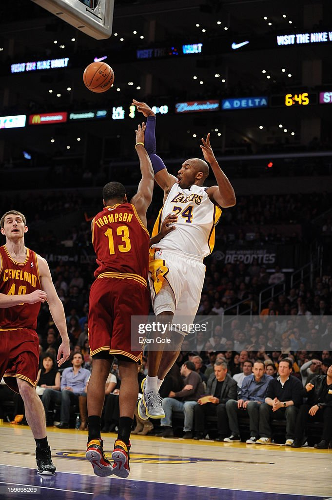 Kobe Bryant #24 of the Los Angeles Lakers passes the ball against Tristan Thompson #13 of the Cleveland Cavaliers at Staples Center on January 13, 2013 in Los Angeles, California.
