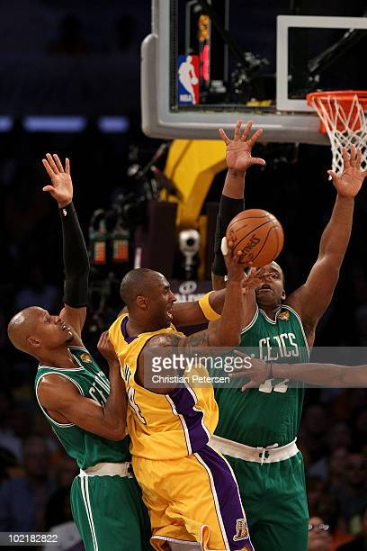 Kobe Bryant of the Los Angeles Lakers passes the ball under pressure from Ray Allen and Glen Davis of the Boston Celtics in Game Seven of the 2010...