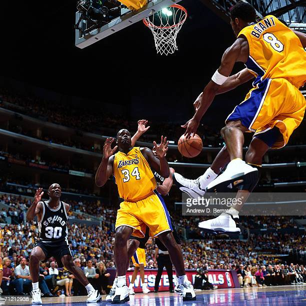 Kobe Bryant of the Los Angeles Lakers passes to teammate Shaquille O'Neal during a game against the San Antonio Spurs at Staples Center in Los...