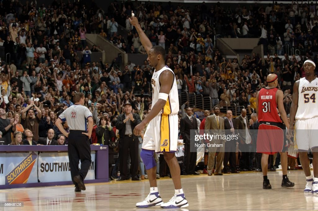 Kobe Bryant #8 of the Los Angeles Lakers points in the air in a game he scored 81 points in against the Toronto Raptors on January 22, 2006 at Staples Center in Los Angeles, California.