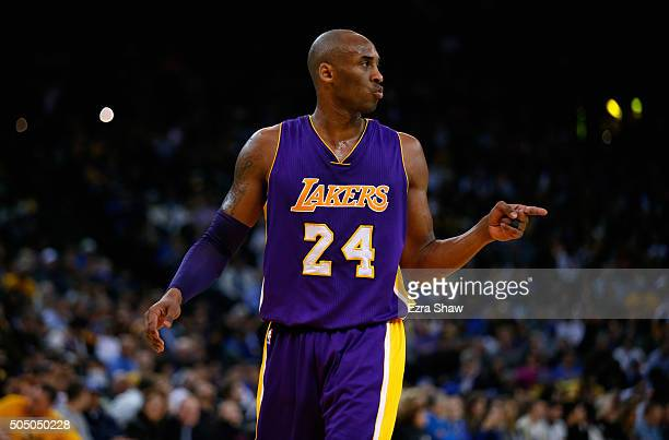 Kobe Bryant of the Los Angeles Lakers points to a teammate during their game against the Golden State Warriors at ORACLE Arena on January 14 2016 in...