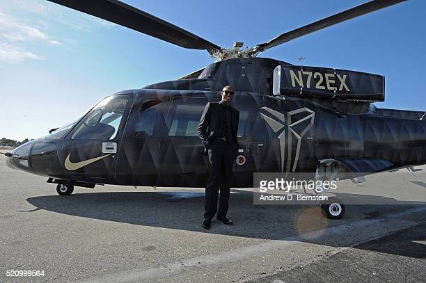 Kobe Bryant of the Los Angeles Lakers poses for a photo in front of the helicopter he took to his last game against the Utah Jazz on April 13 2016 at...