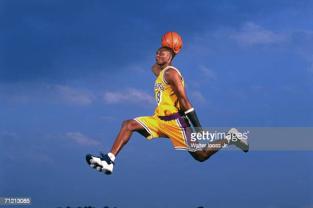 Kobe Bryant of the Los Angeles Lakers poses for an action portrait during a photo shoot session in 1997 in Los Angeles Callifornia NOTE TO USER User...